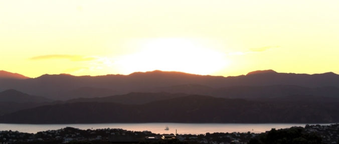 A sailboat under the New Year sunrise over Wellington.